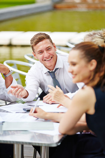 Smiling Businessman Looking At Colleague During Business Meeting