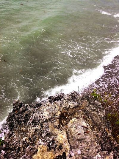 In Oceans Deep. My FAITH Will Stand! Surf Wave Beach Water Motion Sea Power In Nature Sand Nature Shore Scenics Day Beauty In Nature Outdoors Splashing Rock Formation Solitude Tranquil Scene Non-urban Scene Remote Amazingcreation Summer Travel Destinations Photography