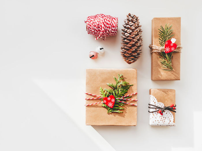 High angle view of christmas decoration on table against white background