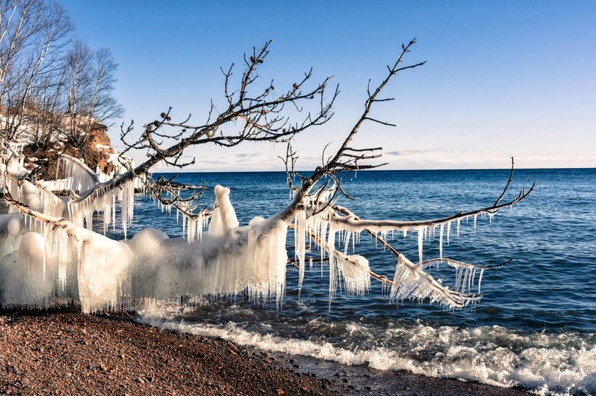 Ice formations Lake Superior Ice Streamzoofamily Malephotographerofthemonth Sea Water Beauty In Nature Scenics Horizon Over Water Nature Sky Beach Outdoors No People Wave Tree Bare Tree