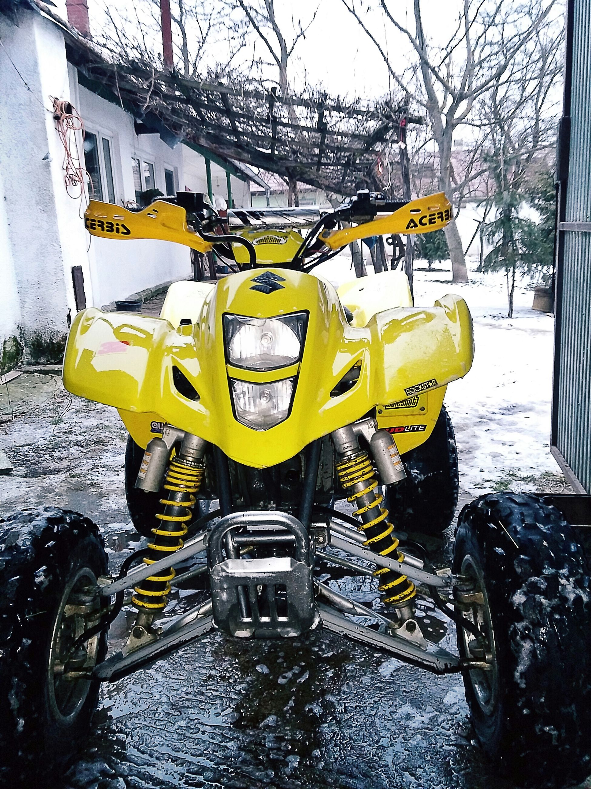transportation, mode of transport, land vehicle, yellow, street, car, season, bicycle, stationary, parking, outdoors, water, day, tree, parked, road, weather, sidewalk, winter, travel