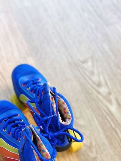 Close-up of blue shoes on hardwood floor
