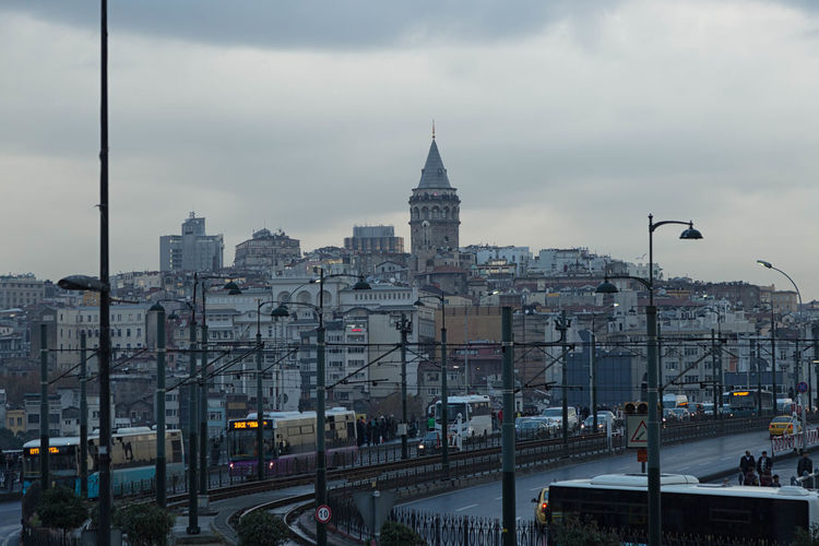 Galata Tower Architecture Built Structure Capital Cities  City City Life City Street Cityscape Cloud Cloud - Sky Cloudy Day Galata Tower Galatakulesi Istanbul Turkey Mode Of Transport Modern No People Outdoors Public Transportation Road Sky Street Tramway Travel Destinations