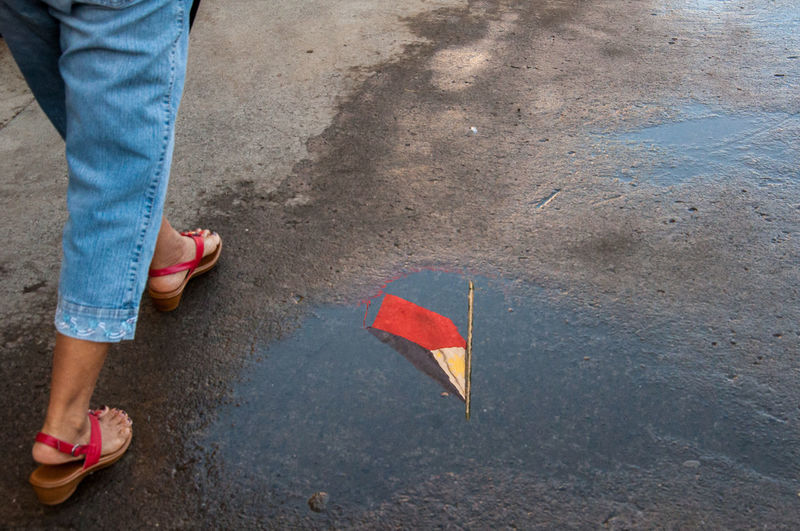 Flanuering in color Baby Eyeem Philippines Flag Philippine Flag Philippines Puddle Puddle Reflections Spongebob Street Street Photography Streetphoto_color Streetphotography The Street Photographer - 2016 EyeEm Awards Urban Urbanphotography EyeEm Philippines: Our Independence Day 2016