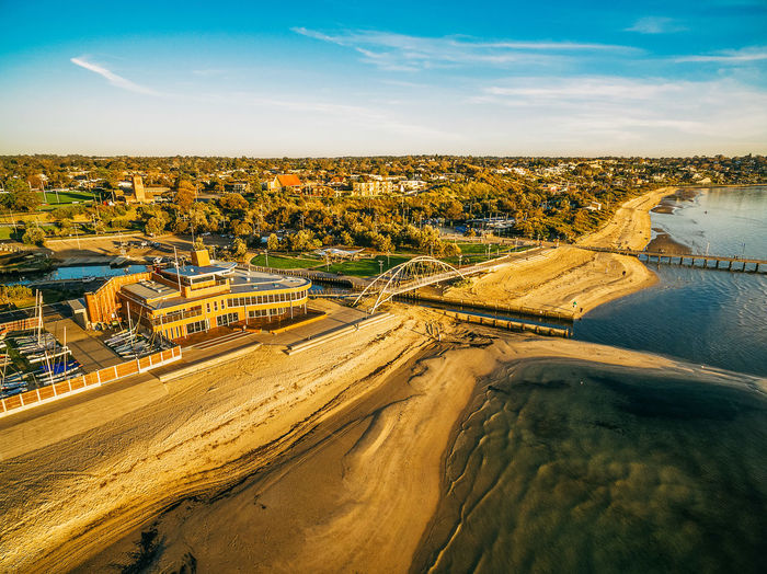 Aerial view of Frankston yacht club and footbridge at sunset. Melbourne, Australia Aerial Shot Australia Drone  Frankston Panorama Panoramic Pier Aerial Aerial Landscape Aerial Photography Aerial View Architecture Beauty In Nature Building Exterior Built Structure City Cityscape Cloud - Sky Day Drone Photography Environment Foreshore Fuel And Power Generation High Angle View Kananook Melbourne Nature No People Outdoors River Scenics - Nature Sky Sunset Travel Travel Destinations Water Waterfront Yacht Club