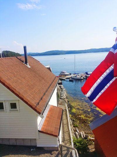 Lindås Brygge Norwegian Landscape Lindas Hordaland Norway Europe Flag Horizon Over Water 2014 Water Sea Clear Sky Red Roof Sky National Flag