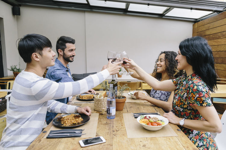 Noodles Caucasian Celebration Celebratory Toast Chinese Cutlery Drink Drinking English Girl Enjoyment Food And Drink Four People Four Persons Friends Group Friendship Multiethnic Group Pasta Pasta Time Restaurant Table Togetherness Tomatoes Water Bottle  Wine Cup Young Women
