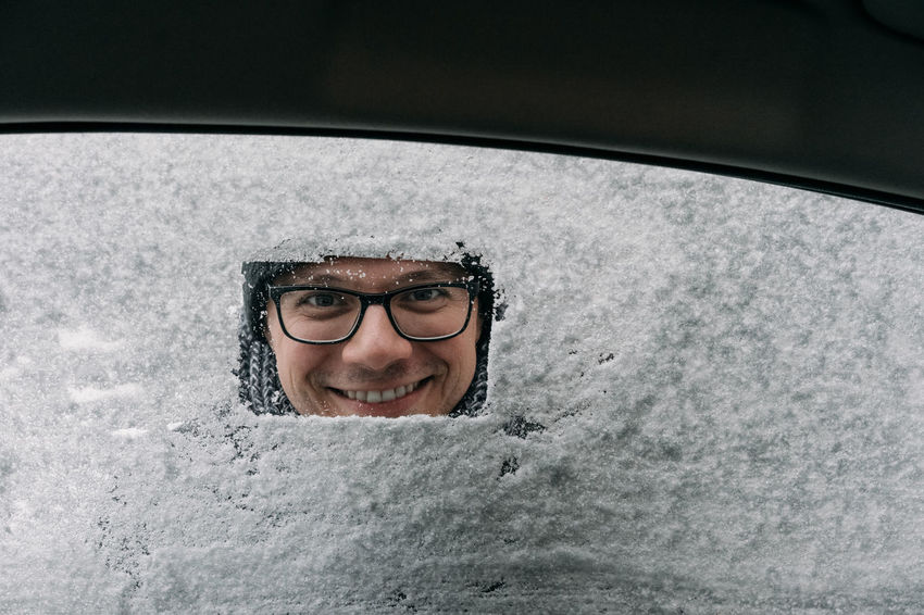 Winter Snow Car Window Covered In Snow One Person One Man Only Smile Smiling View From The Car Eyeglasses  Portrait Human Face Glasses Mid Adult Headshot Close-up Cold Cold Temperature Deep Snow Frozen Snow Covered
