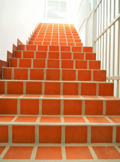 Staircase against brick wall of building