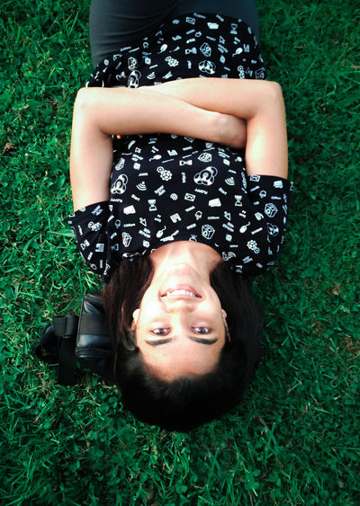 Happy young woman lying on grass. Happy Positive Young Beautiful Woman Carefree Femininity Girl Glowing Grass Green Grass High Angle View Leisure Activity Lifestyles Looking At Camera Lying Down Lying On Back One Person Portrait Pretty Relaxation Smiling Smiling Face Summer Sunlit Young Adult The Week On EyeEm Mix Yourself A Good Time