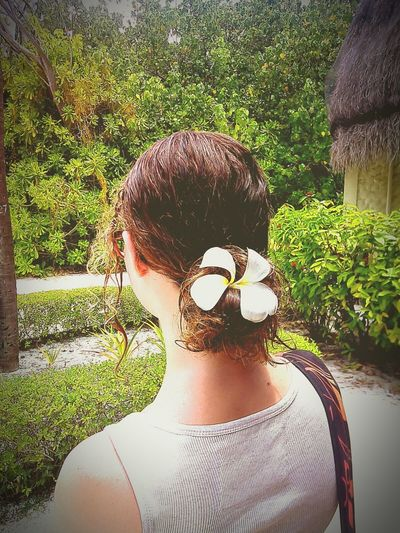 Flower Flower In Hair Green Beach Hut Girl Sand Trees Looking Into The Distance Bun Stylish Hairstyle.