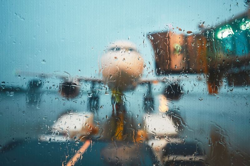A busy airport in the rain. A view through a wet window on the airplane before flight. Delay Gate Plane Rain Storm Transportation Travel Traveling Weather Aerospace Industry Aircraft Airplane Airport Airport Waiting Airportphotography Aviation Aviationphotography Drop Glass - Material Gloomy Journey RainDrop Water Wet Window Fresh On Market 2017