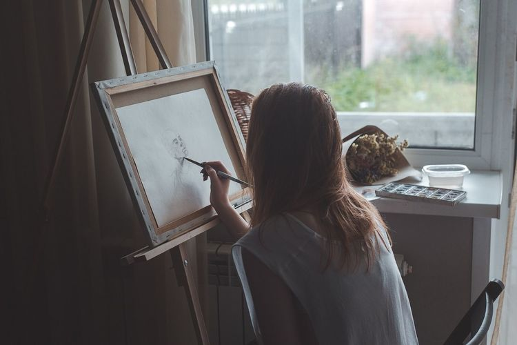 Artist Rear View Easel Indoors  Leisure Activity Window Real People One Person Lifestyles Day Women Art Studio Human Hand Young Adult People