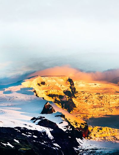 Fiery mountain Beauty In Nature Glacier Sunrise Iceland Mountain Beauty In Nature Water Scenics - Nature Sky Sea Nature Tranquility Cloud - Sky Tranquil Scene No People Land Rock Orange Color