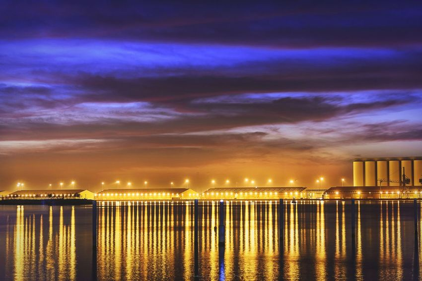 Trails Night Sky Illuminated Built Structure Architecture Outdoors Sunset Urban Skyline Building Exterior City Business Finance And Industry Cloud - Sky Travel Destinations Downtown District Cityscape Reflection No People Sea Water Beach