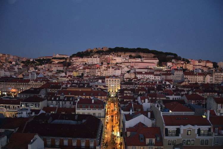 View of buildings in city at dusk
