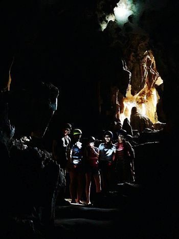 Cave and the Lady at the back praying. People Caves Photography Friendship Travel Philippines