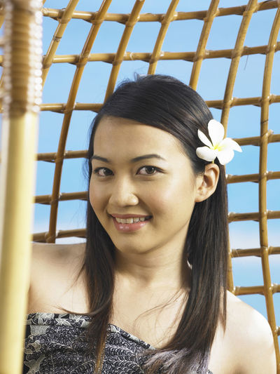 asian woman relax on the swing Asian  Confidence  Happiness Happy One Person Only Woman Attractive Beautiful Woman Beauty In Nature Day Head And Shoulders Mixed Race Person One Person Portrait Rattan Swing Simplicity Sky Smile Women Young Adult Young Women