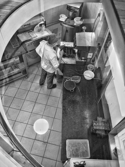 High angle view of child in kitchen