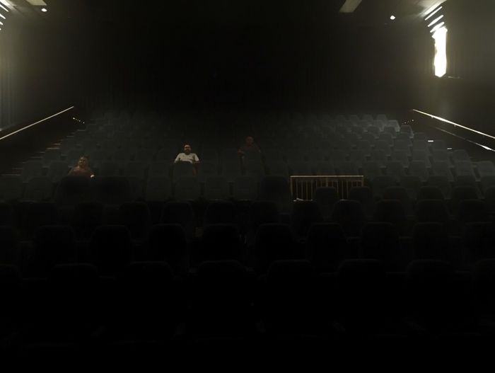 Empty theater waiting for a few more patrons. Theater Guests Guest Empty Expectation Seats MOVIE Movie Night Performance Event Nightlife Stage - Performance Space Small Group Of People Arts Culture And Entertainment Indoors  Vacancy Ticket Stadium Seating No End No Horizon Ghostly Patrons People Watching