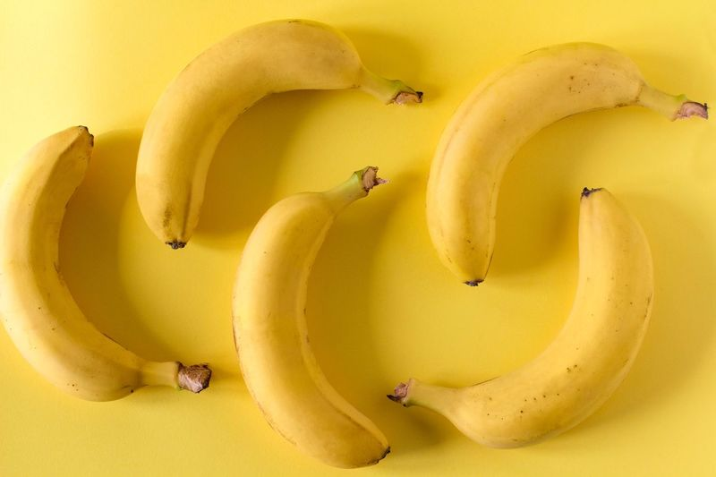 Bananas in a row on yellow background Individuality Healthy Food Healthy Eating Vegetarian Dieting Organic Vitamin Vegan Food Creativity Raw Food Tropical Sweet Food Design Minimalism One Color Monochromatic Monocrome Summertime Simple Yellow Banana Fruit Food Directly Above Freshness Wellbeing Still Life