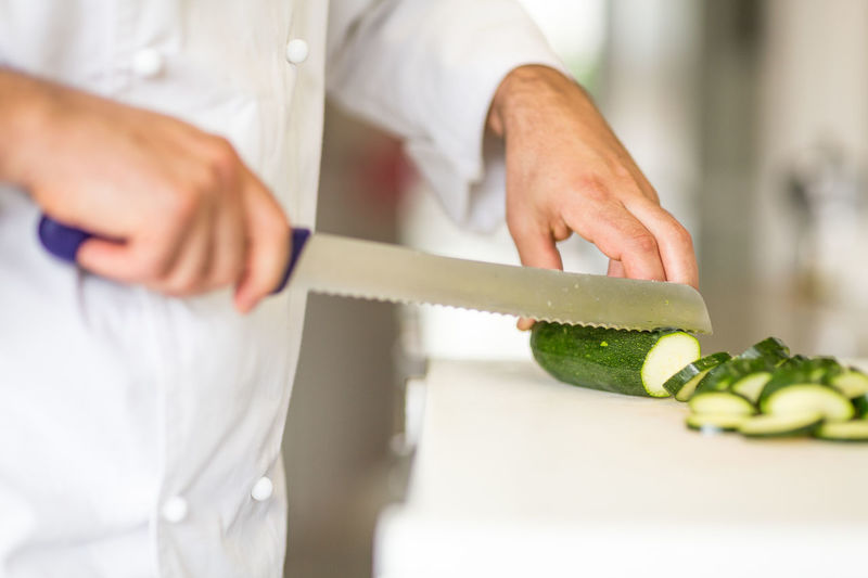 Adult Adults Only Chef's Whites Close-up Cutting Day Freshness Human Body Part Human Hand Indoors  Occupation One Person People Recipe Working Zucchini
