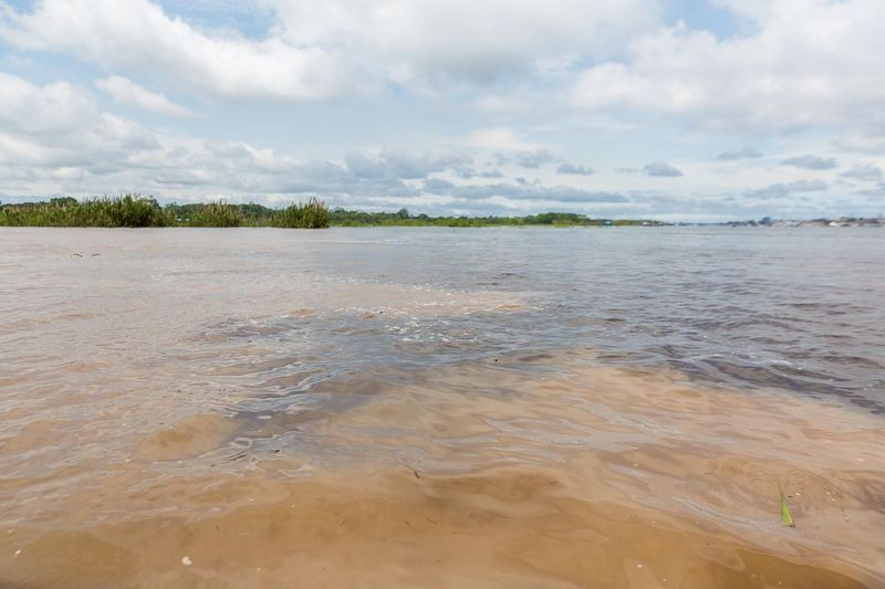 Two kinds of water meeting in the amazon river. Landscape Tourism Beauty In Nature Water Amazon River Tributary Two Waters Mixing Water Amazon Peru Nature