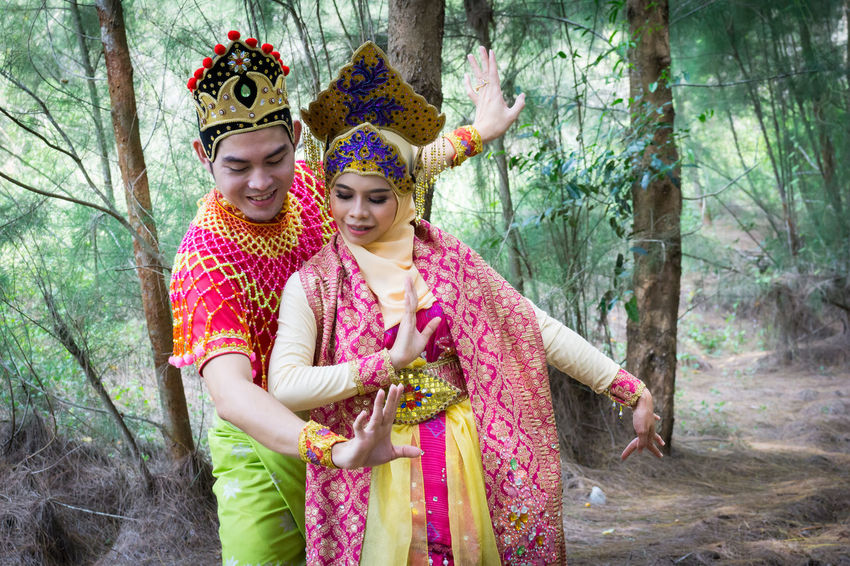 Specific to the villages of Kelantan, where the tradition originated, Mak Yong is performed mainly as entertainment or ritual purposes by couple of dancers. Adult Adults Only Crown Day Forest Headwear Human Hand Lifestyles Mak Yong Nature Outdoors People Real People Smiling Standing Togetherness Traditional Clothing Tree Tree Trunk Two People Young Adult Young Women