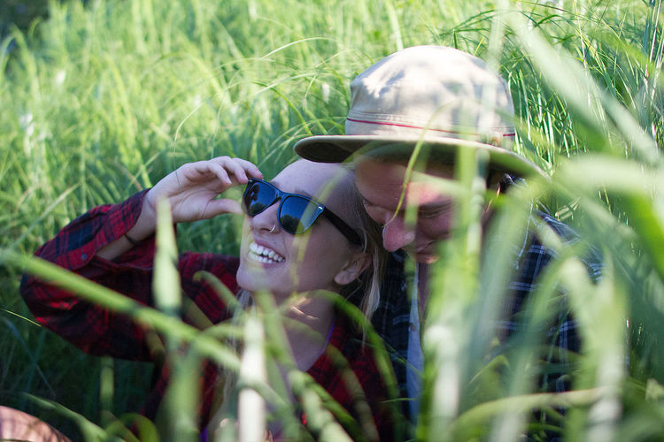 Adult Adults Only Adventure Day Eyeglasses  Field Grain Grass Growth Headshot Leisure Activity Lifestyles Nature One Person Outdoors People Portrait Real People Selective Focus Smiling Summer Sunglasses Tall Grass Young Adult Young Women