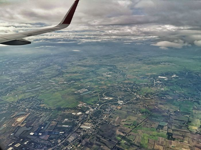 Aerial view of landscape with airplane window
