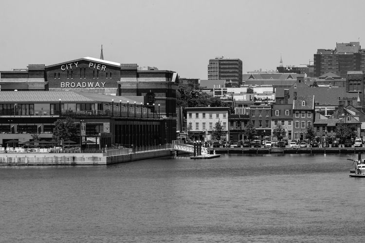 Baltimore, Fellspoint Baltimore Maryland Baltimore Blackandwhite Black And White Phase Blackandwhite Photography Black And White Collection  Bars And Restaurants Building Exterior Built Structure Architecture City Sky Building Nature Day Street Residential District Outdoors Clear Sky Transportation City Life Cityscape Water Sunlight Road The Street Photographer - 2018 EyeEm Awards