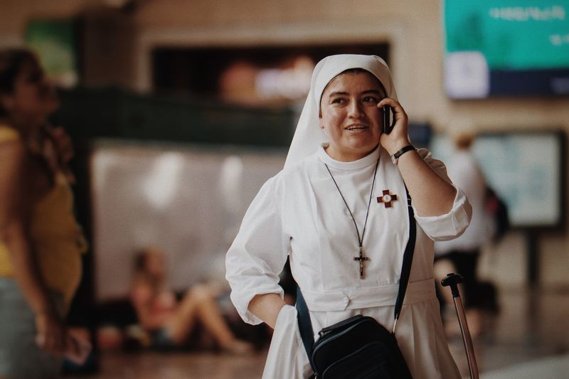 Calling VSCO Vscocam Nun Focus On Foreground Listening Using Phone Communication Arts Culture And Entertainment Real People One Person People Day Stories From The City The Street Photographer - 2018 EyeEm Awards