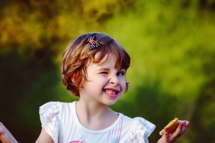 Portrait Of Girl Winking