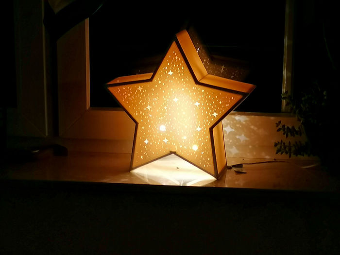 High angle view of illuminated lantern at home