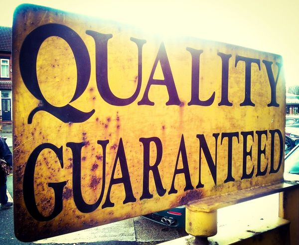 "Quality Guarantee.. that you get with The Big Town. Taken in ""lovely"" Chorlton. Sign Quality Reassurance Advertisement Yellow Metal Sign Manchester"