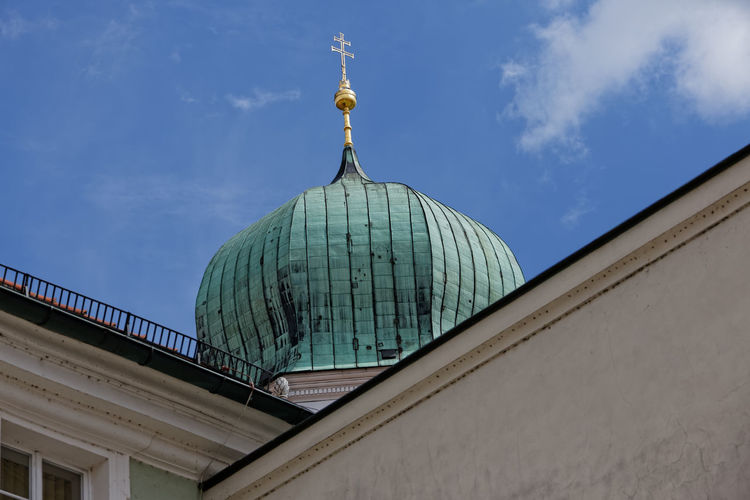 Low angle view of church dome against sky