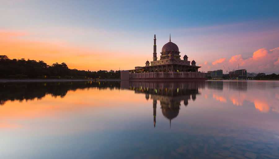 The image is part of my time lapse sequence taken this morning. I often visit this mosque for my soul searching session, and this morning I was lucky that the Putrajaya lake was calm for a short while for me to capture the reflection of the beautiful morning with the Putra Mosque of Putrajaya. Certainly a spot that I would return in the future. Architecture Building Exterior Built Structure City Dome Famous Place History International Landmark Lake Orange Color Place Of Worship Reflection Religion Scenics Sky Spire  Spirituality Sunset Symmetry Tourism Travel Destinations Water Waterfront