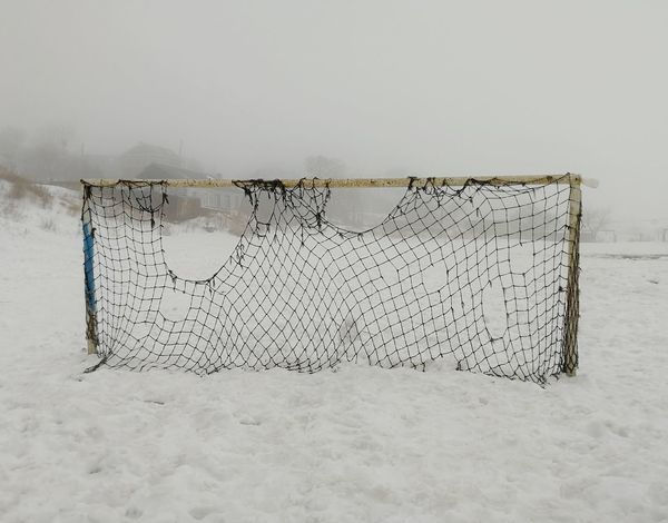 Football gate on a background of a foggy landscape Goal Gate Football Football Gate Football Field Football Goal Net Snow Wet Fog Foggy Day Old March Spring Sky