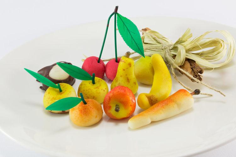 Choice Close-up Food Food And Drink Freshness Fruit Garnish Healthy Eating Indoors  Indulgence Marzipan Fruits Multi Colored No People Orange Plate Ready-to-eat SLICE Still Life Studio Shot Table Temptation Variation Wellbeing White Background