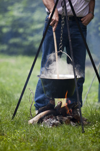 Cooking a meal in the nature. Campfire soup. Camp Fire Campfire Camping Cooking Meal Picnic Smoke Boiling Boiling Stew Campfire Cooking Campfire Pot Camping Stove Cooking Outdoors Fire Firewood Forest Leisure Activity Lifestyles Nature Outdoors Preparation  Preparing Food Real People Scout Camp