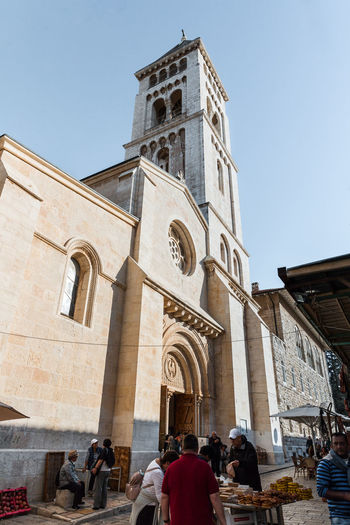 Jerusalem, Israel, November 17, 2018 : The bell tower above the entrance to the Alexander Nevsky church in Jerusalem, Israel Jerusalem Israel Jesus Christ Religion Orthodox History Heritage Icon Christianity Alexander Nevsky Church Interrior Russian Old City Palestine Holy Wall - Building Feature Stone Material Cross Travel Destinations Pilgrimage Altar Tourism Prayer Landmark Bible Culture
