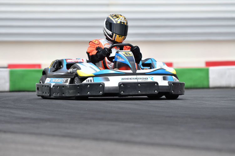 Sport Competition Motorsport Sports Race Racecar Driving Motor Racing Track Mode Of Transportation Sports Helmet Transportation Headwear Crash Helmet One Person Auto Racing Helmet Competitive Sport Professional Sport Speed Skill  Gokart