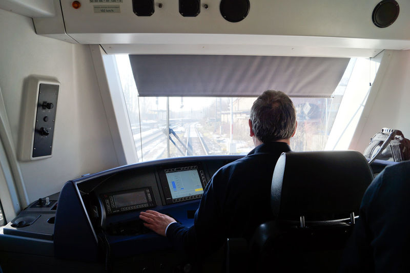 Rear View Of Male Engineer Driving Train