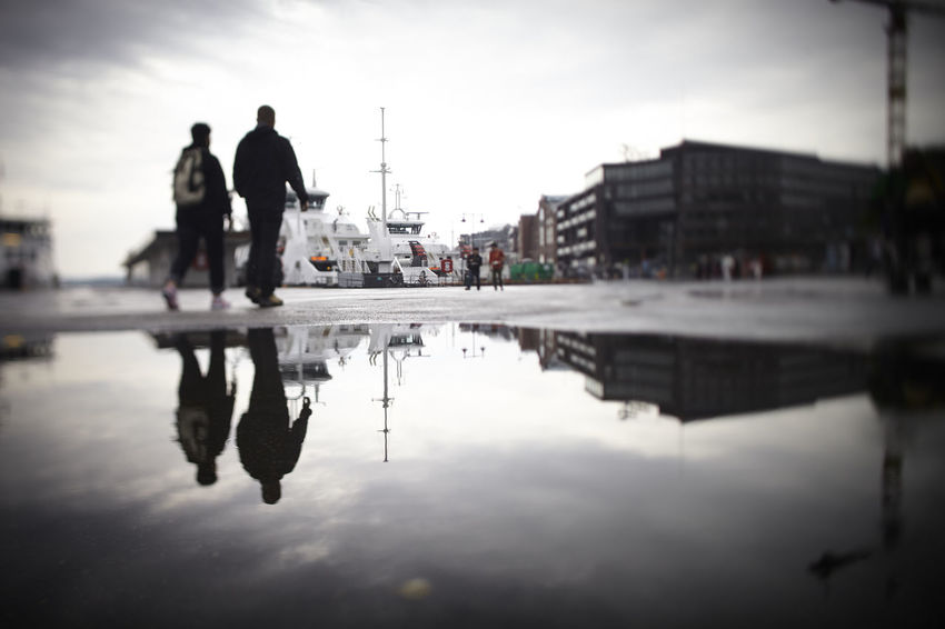 Couple walking through Oslo harbor Adult Adults Only Architecture City Cityscape Day Harbor Nautical Vessel Nordic Norway Oslo Outdoors People Promenade Rain Reflection Relaxing Scandinavia Scandinavian Sky Unrecognizable People Vignette Water Wet Winter