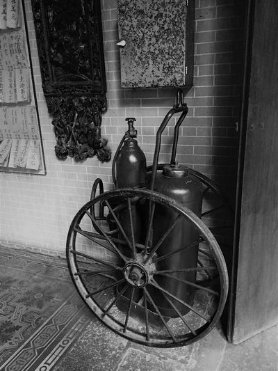 Fire Extinguisher Architecture Black And White Building Building Exterior Built Structure Day History House Metal No People Old Outdoors Retro Styled The Past Transportation Wall Wall - Building Feature Wheel Window