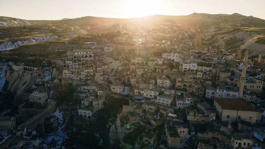 High angle view of townscape against sky at sunset
