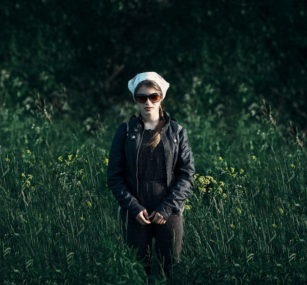 Russia Clothing Day Fashion Field Front View Glasses Grass Green Color Growth Land Leisure Activity Lifestyles Nature One Person Outdoors Plant Portrait Real People Standing Three Quarter Length Young Adult Plant Green Color Growth Nature Standing Field Grass Casual Clothing