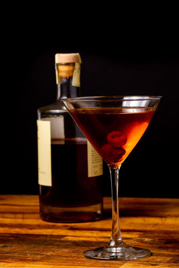 martini drink and bottle Cocktail Manhattan Martini Rum Alcohol Bar - Drink Establishment Bar Counter Black Background Bourban Cocktail Drink Food Food And Drink Freshness Fruit Glass Indoors  Luxury Martini Glass No People Raspberry Refreshment Still Life Whiskey Wood - Material EyeEmNewHere