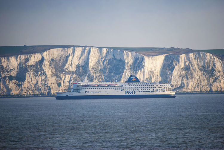 A ferry passing next to the white cliffs of Dover in the English Channel Dover Kent England English Channel White Cliffs  White Cliffs Of Dover Ferry Passenger Ferry Cross Channel Ferry Nautical Vessel Transportation Sea No People Ship Waterfront Passenger Craft Sky Mode Of Transportation Nature Travel Outdoors Non-urban Scene Day Water Cruise Ship