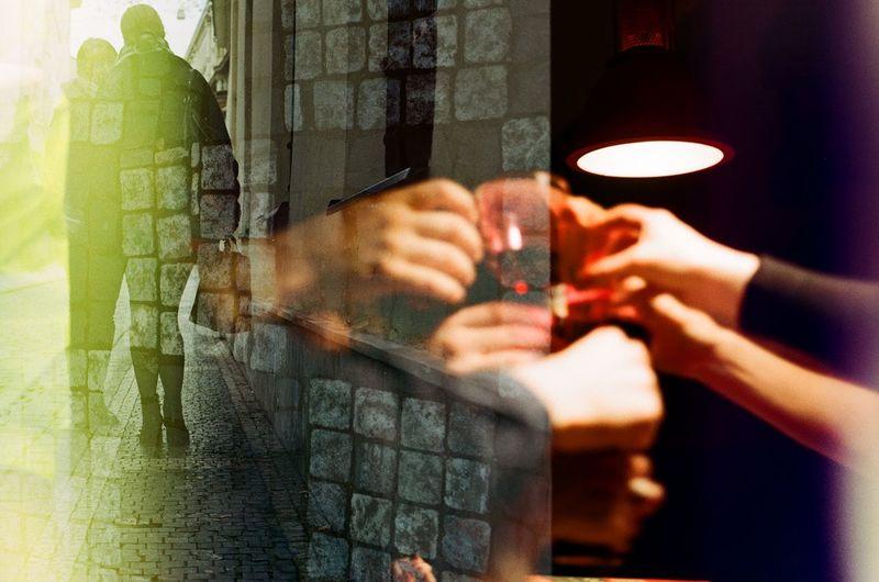Double Exposure Of People Toasting Drinks And Couple On Sidewalk